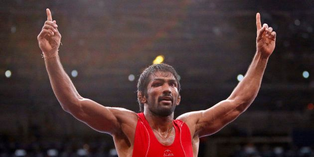 Yogeshwar Dutt celebrates his victory at the London Olympic Games in 2012. REUTERS/Suhaib