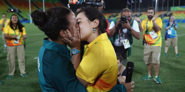 Volunteer Marjorie Enya (R) and rugby player Isadora Cerullo of Brazil kiss after proposing marriage...