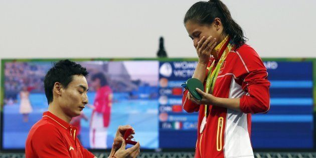 Silver medallist China's He Zi receives a marriage proposal from Olympic diver Qin Kai of