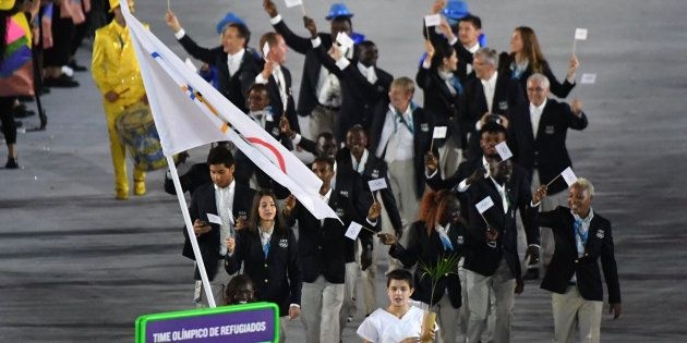 Refugee Olympic Team's Rose Nathike Lokonyen leads her delegation during the opening ceremony of the...