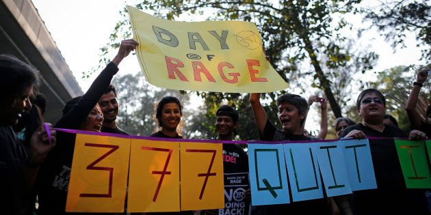 Gay rights activists shout slogans during a protest against the verdict by the Supreme Court in Mumbai...