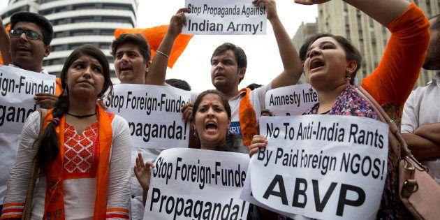 Supporters of Akhil Bharatiya Vidyarthi Parishad (ABVP), the students wing of the ruling Bharatiya Janata...