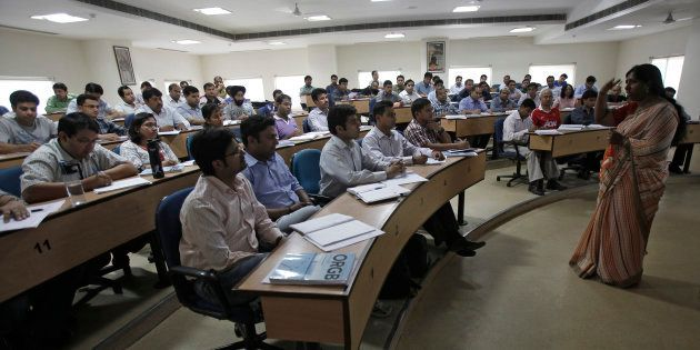 MBA students attend a lecture at a classroom at the Management Development Institute (MDI) in Gurgaon,...