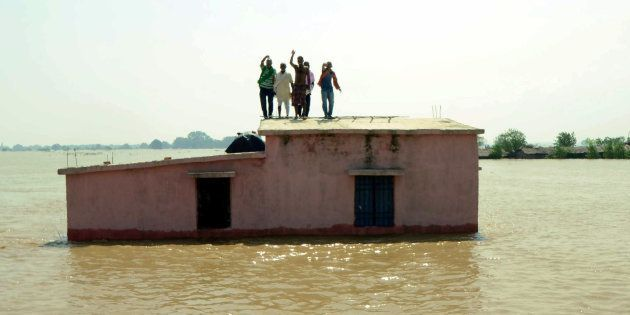 Flood affected people wait to be rescued at Kasimpurchak in