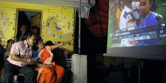 Dipa Karmakar parents, Dulal Karmakar and Gouri Karmakar, watch Dipa in the vault finals of the gymnastics