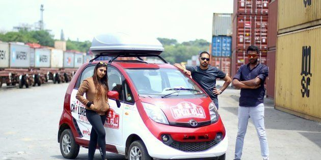 Sunaina Pamudurthy, Binoy John and Bhairav Kuttaiah with their Tata Nano