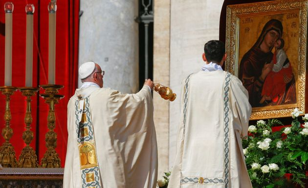 Pope Francis blesses with an incense burner as he leads a mass for the canonisation of Mother