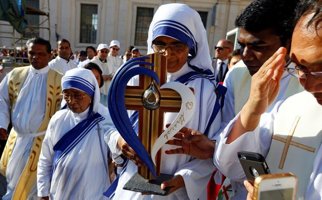 A nun, belonging to the global Missionaries of Charity, carries a relic of Mother