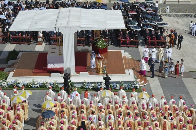 Nuns of the Missionary of Charity prays during a holy mass for canonisation of Mother