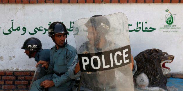 Representative image. Afghan policemen keep watch during a demonstration by Afghanistan's Hazara minority...
