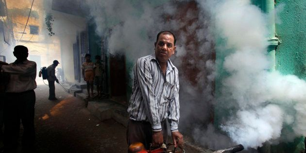 File photo of a Municipal Corporation of Delhi worker fumigating a residential