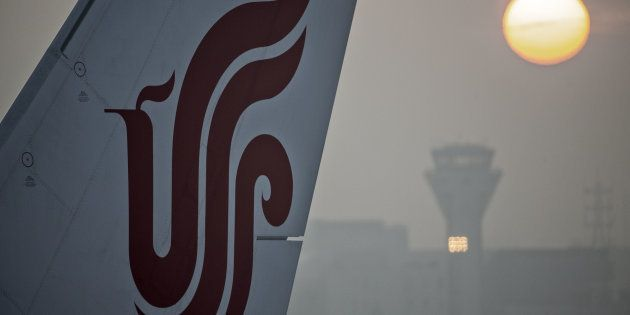 The tail fin of an Air China Ltd. aircraft is seen at Shanghai Hongqiao International Airport in Shanghai,...