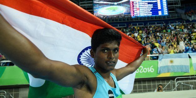India's Mariyappan Thangavelu poses after winning the gold medal in the men's final high jump - T42 during...