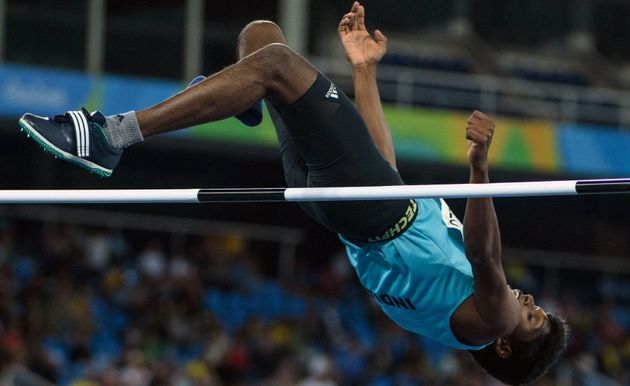 India's Mariyappan Thangavelu jumps in the men's final high jump - T42 during the Paralympic Games at...