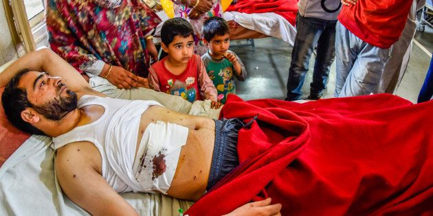 A Kashmiri Muslim man lies wounded on a hospital bed after government forces fired pellets on September...