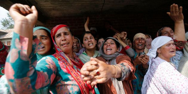 Kashmiri women shout for freedom slogans during a funeral procession of a Javed Ahmad Dar at Wadwan Budgam...