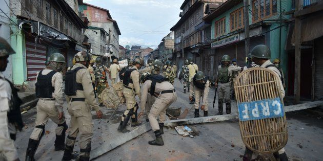 Indian security forces clear road blockades following clashes with Kashmiri protestors in Srinagar on...