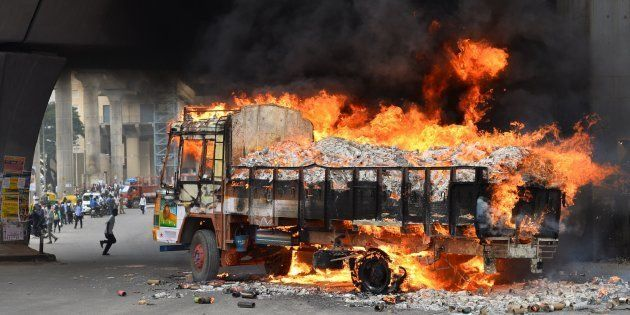 A truck from neighbouring Tamil Nadu burns after it was set alight by agitated pro-Karnataka activists...