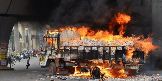 A truck from Tamil Nadu burns after it was set alight by agitated pro-Karnataka activists in Bangalore...