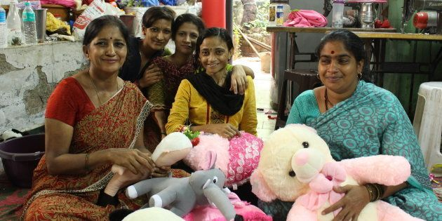 Amita Gupta (left) making one of the Modi dolls with her staff at her toy manufacturing