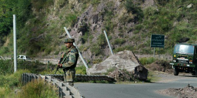 An Army man stand guards near Army Brigade camp during a terror attack in Uri, Jammu and Kashmir on