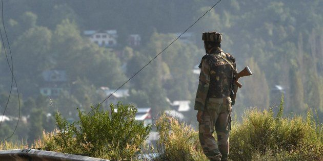 An Army soldier near Army Brigade camp during a terror attack in Uri, Jammu and Kashmir on