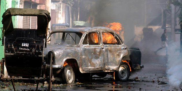 File photo of a car torched by protestors during a protest march in Kolkata, November 21,