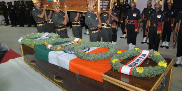 Army personnel arranging remains of late soldiers, who were killed in Uri terror attack, at Birsa Munda...
