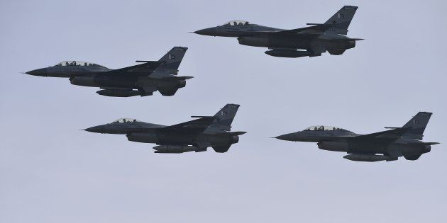 Pakistani F-16 fighter jets fly past during the Pakistan Day military parade in Islamabad on March 23,