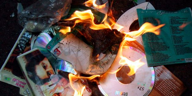 Members of MNS burn music disks of Pakistani artists during a protest against Pakistan government in