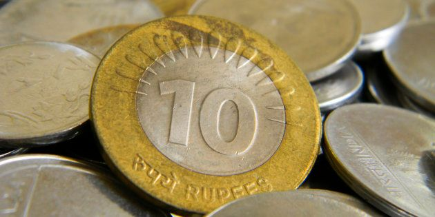 Ten rupee coin of Indian currency lying on top of other
