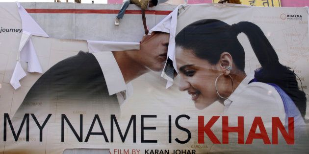 Supporters of Hindu hardline group Shiv Sena tear a poster of Bollywood actor Shah Rukh Khan's