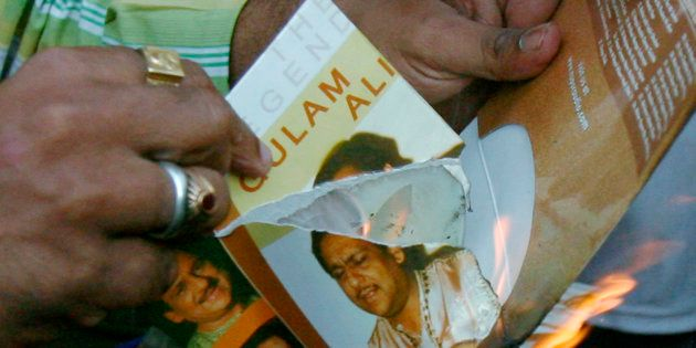 Members of Maharashtra Navanirman Sena (MNS) burn music disks of Pakistani artists during a protest against...