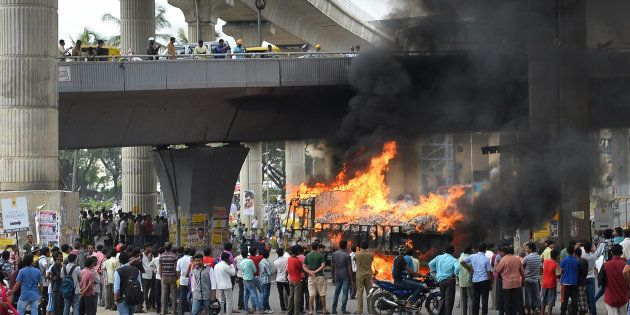 A vehicle is set alight by pro-Karnataka activists as the Cauvery water dispute erupted following the...