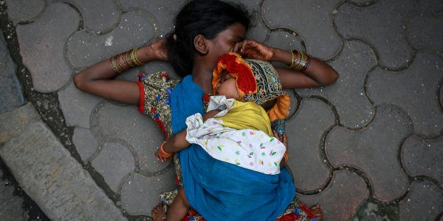 (Representational image) File photo of a woman sleeping with her baby on