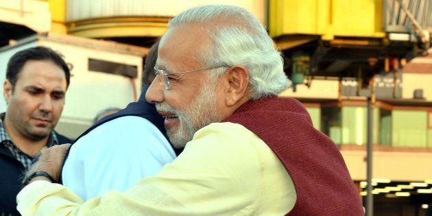 Prime Minister of Pakistan Nawaz Sharif (L) welcomes Indian Prime Minister Narendra Modi (R) at Allama...