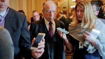 Sen. Chuck Grassley, R-Iowa, center, is questioned by reporters on Capitol Hill in Washington, Wednesday, Nov. 14, 2018, in Washington. Grassley will serve as Senate pro tempore, which means he will preside over the Senate in the Vice President's absence and is third in line of presidential succession. (AP Photo/Pablo Martinez Monsivais)