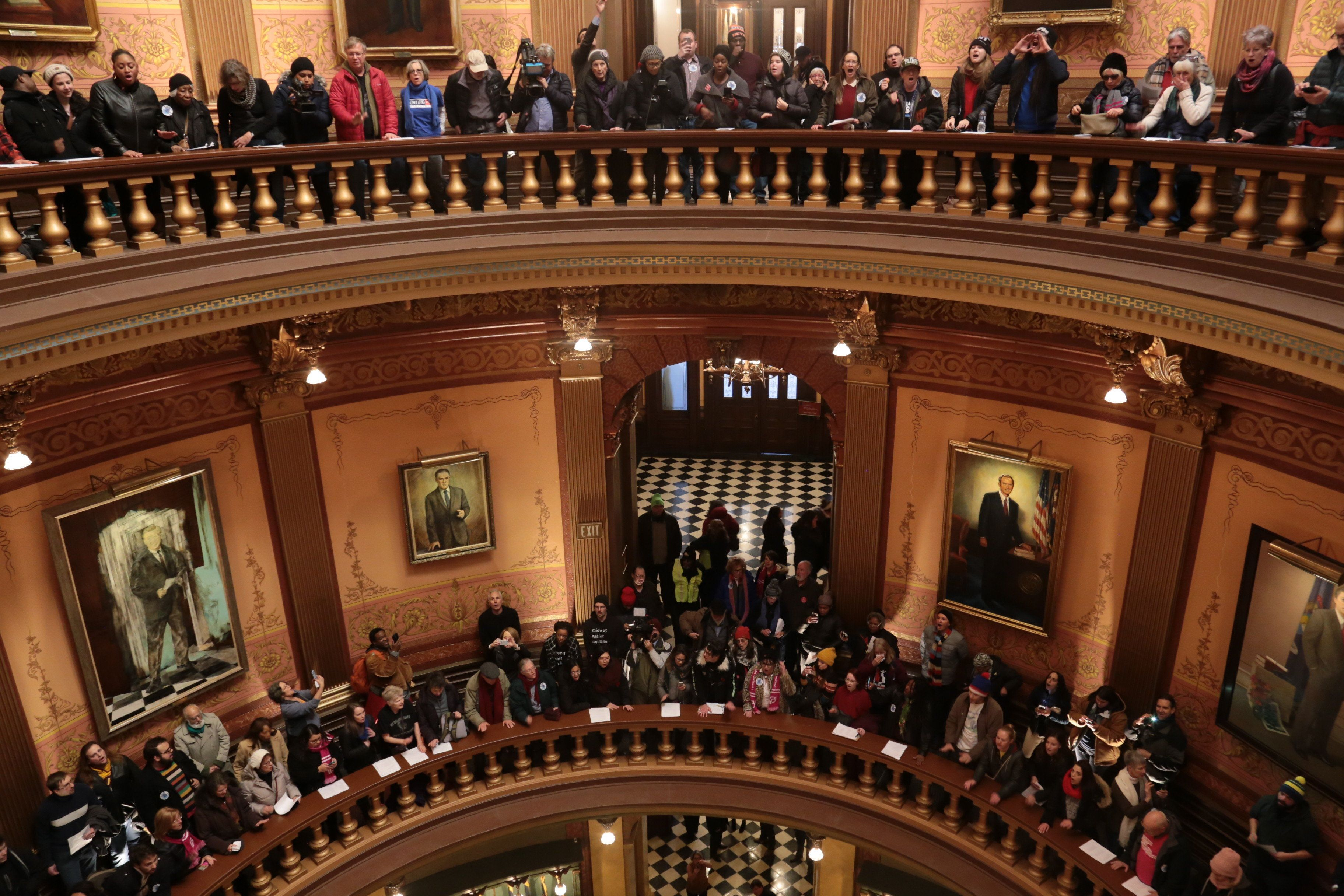 Protesters gather in the Michigan Capitol's rotunda.