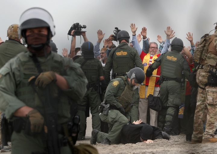 U.S. Border Patrol agents make arrests during a pro-migration protest by members of various faith groups.