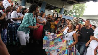 Afro-Brazilians dance in Madureira underneath a bridge on Nov. 20, 2018.