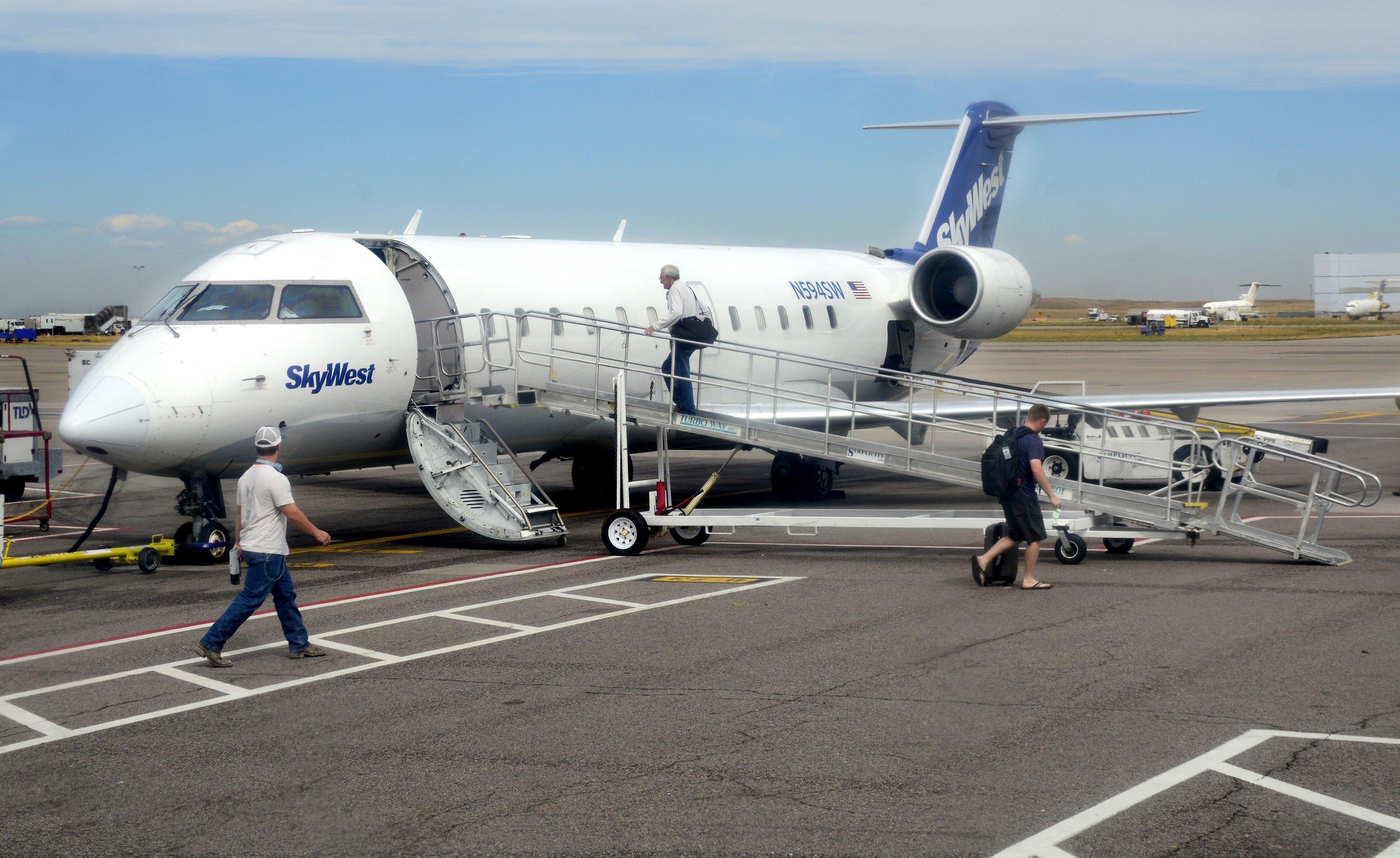 DENVER, CO - September 7, 2016:  Passengers board a SkyWest Airlines Bombardier CRJ-100 passenger plane at Denver International Airport on September 7, 2016. (Photo by Robert Alexander/Getty Images)