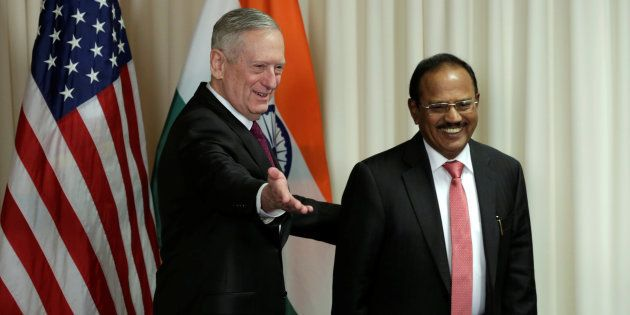 U.S. Defense Secretary James Mattis (L) welcomes Ajit Doval, National Security Advisor of India, before...