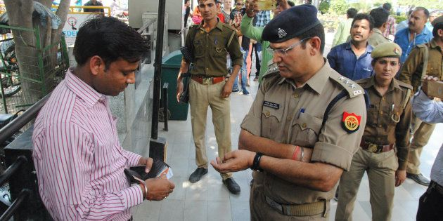 Lucknow Police run an anti-Romeo operation at Saharaganj mall, on March 22, 2017 in Lucknow,