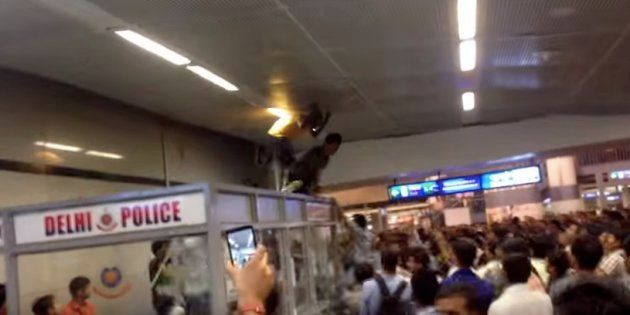 Screen grab of a video showing how three men from Africa were beaten up mercilessly in Rajiv Chowk metro...