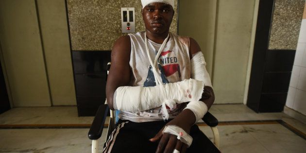 One of the injured admitted at Kailash Hospital post-violence on Monday evening in racial attacks on...