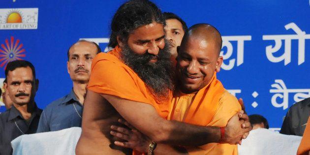 Yog Guru Baba Ramdev and Chief Minister of Uttar Pradesh Yogi Adityanath greeting each other during UP...