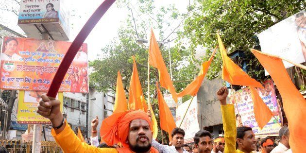 Indian Hindu devotees shouts slogans with sword during the rally on the eve of Ram Navami festival in...