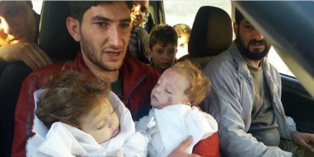 A Father Bids Farewell To Twin Toddlers After Suspected Chemical Attack In