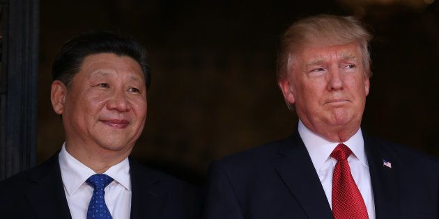 U.S. President Donald Trump welcomes Chinese President Xi Jinping at Mar-a-Lago state in Palm Beach,...