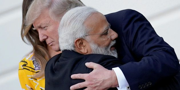 India's Prime Minister Narendra Modi hugs U.S. President Donald Trump as he departures the White House...